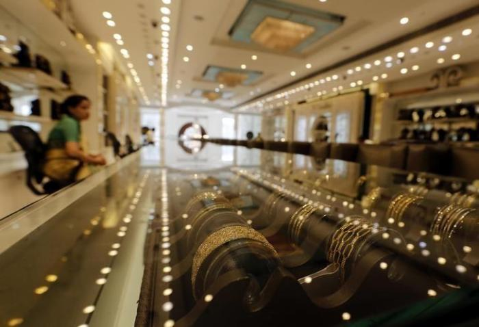 Gold jewellery is displayed at a shop in New Delhi